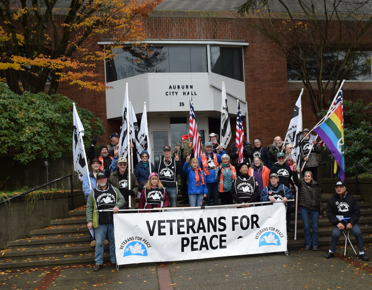 Seattle Peace Chorus Action Ensemble posing with Veterans for Peace before the Auburn City Hall